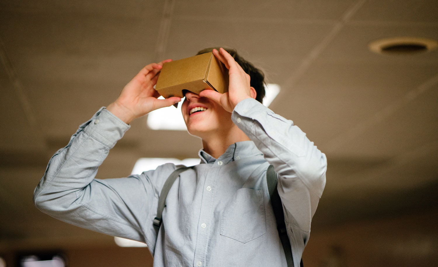 Man in Grey Dress Shirt Using Brown Cardboard Vr Glasses - Photo by mentatdgt from Pexels